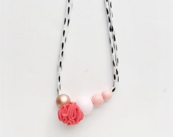 CORAL POM La Fête COLLAB necklace - girls' or women's wood bead and fabric pom necklace in rose gold, pale pink, and peach