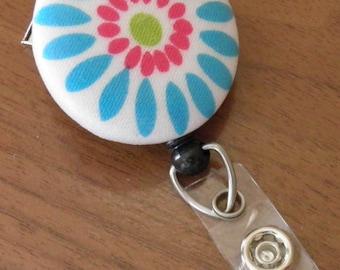 Flower badge reel