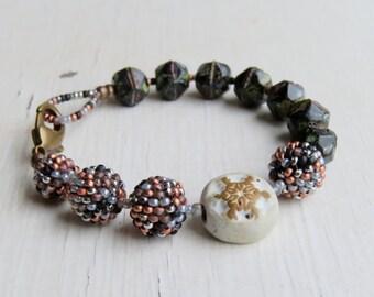 Star light, star bright - handmade snowflake winter christmas black white and copper artisan bead bracelet - Songbead, UK - narrative