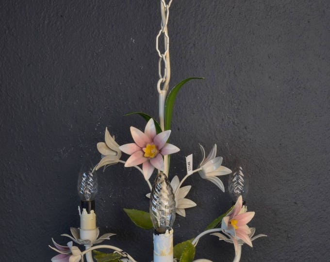 White toleware flower chandelier.