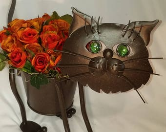 Cat flower pot with flowers