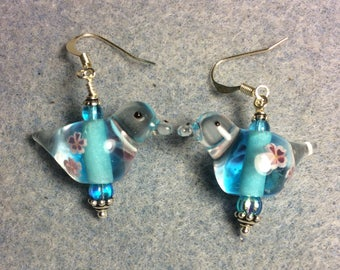 Turquoise lampwork songbird bead earrings adorned with turquoise Czech glass beads.