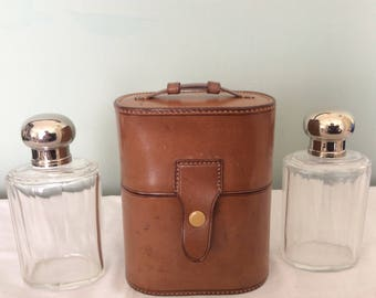 A beautiful pair of Edwardian Gentleman's Cologne Bottles in Lovely Leather Case.