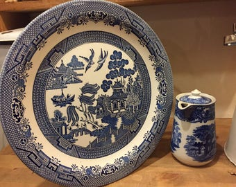 A large serving plate with willow pattern design