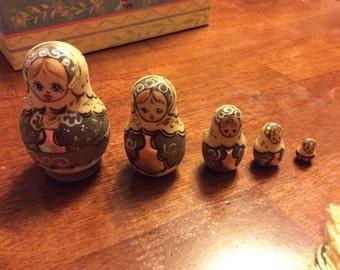 Vintage set of five hand painted Russian babushka dolls