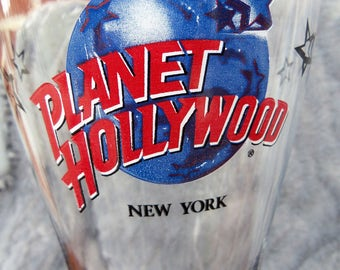 "Planet Hollywood New York Tall Beer Glass, Collectible Souvenir Beer Glass, Stands 8 1/2"" Tall"