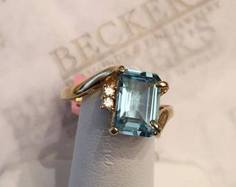 Vintage 18k yellow gold Emerald Cut 10x7mm Blue Topaz and 2 Diamond Bypass Ring, 2.34 tw, size 8.25