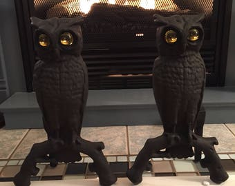Antique cast iron owl andirons with yellow glass eyes
