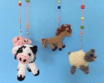 This baby crib mobile has your favourite  farm animals: sheep, cow, horse. pig plus a chicken and duck  roosting in the barn/