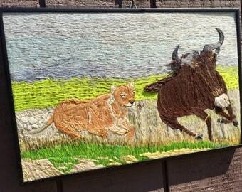 Lion attacking Wilderbeast