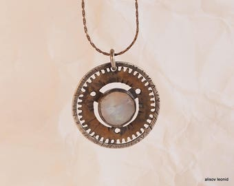 pendant with moonstone. Suspension of items from old clock, a ring of Sterling Silver