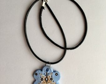 Handmade light blue flower shaped necklace with pattern detail