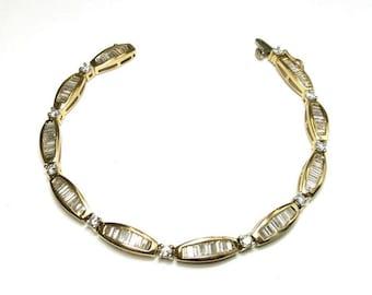 diamond tennis bracelet three carats yellow gold 14k
