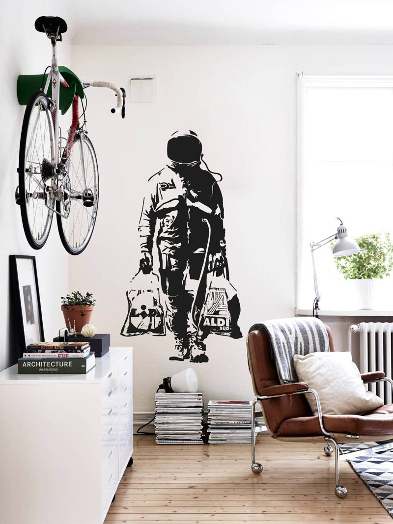 wall decal banksy astronaut shopping street art sticker zoom