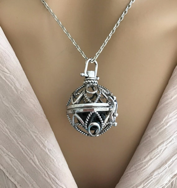 Magic Music Box Locket. Design: Open Loop Silver Filigree Flower. Wear with Lava Stone for Essential Oil Aromatherapy or with Chime Ball.