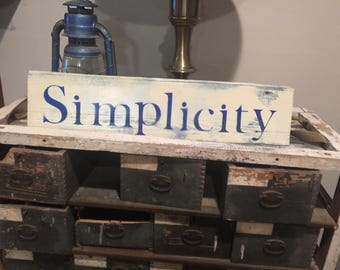 Simplicity sign on reclaimed barn wood.