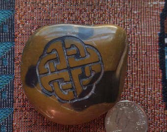 Celtic knot engraved river rock,  browns