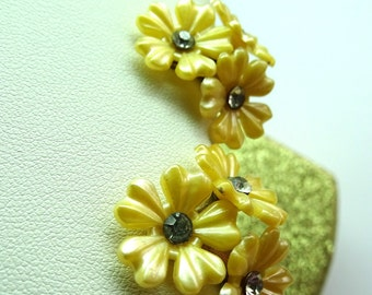 Yellow Daisy earrings marked Caribe. Vintage bunches of daisys on gold tone clip backs.