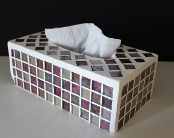 Box tissue covered with a mosaic of glass block