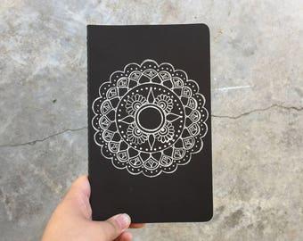 Hand-drawn Mandala on a Med Moleskine Journal