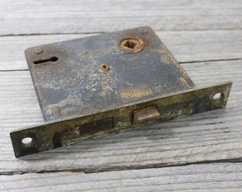 Antique door lock or latch, vintage metal door mechanism