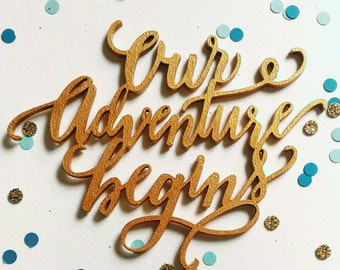Our adventure begins cake topper