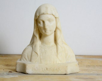 Statuette bust of the Virgin Mary, a religious object, our Lady of Lourdes