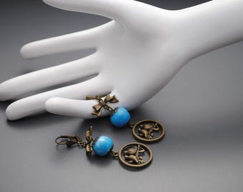 Loop ceramic Blue Bird earrings