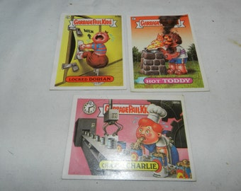 3 Garbage Pail Kids Sticker cards -3 Vintage Collectible Trading Cards - Locked Dorian, Chuckin' Charlie + Hot Toddy -379a, 384b + 385b 2-11