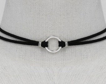 black suede with circular silver tone design