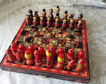 Wooden Chess With Chessmen In The Shape Of Russian Matryoshkas