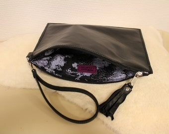 Black shiny leather clutch bag