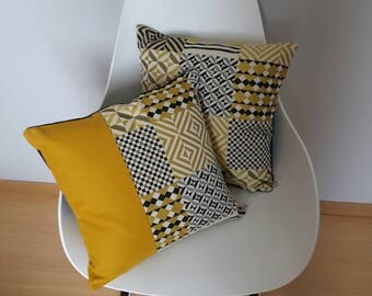 Cushion cover geometric patterns in shades of yellow mustard, grey and black