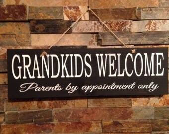 Grandkids welcome parents by appointment sign