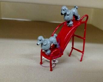 Poodles On A Slide