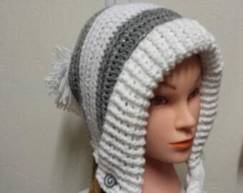 Slouchy, earflap hat with braids and pom pom.