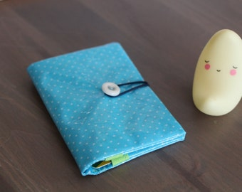 Card holders in coated, turquoise fabric in peas