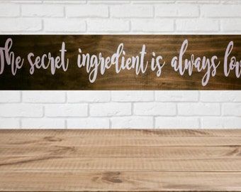 The secret ingredient is always love wood sign