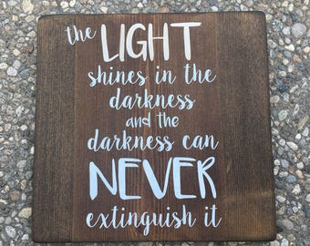 Light Shines in the Darkness - rustic painted wood sign