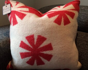 Cream and red wool cushion