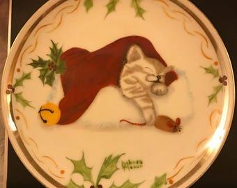 Christmas kitten sleeping in santas hat