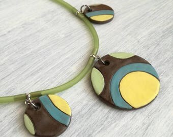 Necklace with Black ceramic medallions on rubber