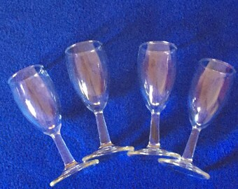 Shot or aperitif glasses. Set of four stemmed glasses for after dinner drinks or shots. Two ounce capacity.