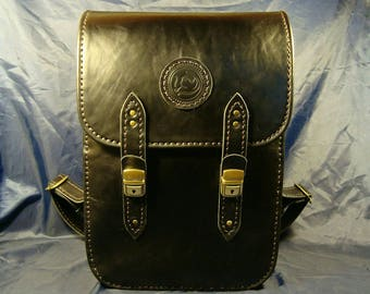 Backpack for traveling out of black leather. Backpack for travel, black leather.