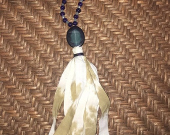 Navy and neutrals tassel necklace with suede adjustsble length