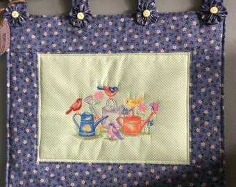 Quilted, embroidered wall hanging...spring birds, watering cans and flowers