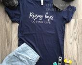 Raising Boys Loving Life © THE ORIGINAL | Boy Mom Shirt | Mom Life Shirt | Trendy Tees | Mother's Day Gift | Women's Shirt | Mom of Boys
