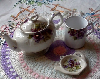 Crownford Giftware teapot with matching cup and teabag holder.  Teapot with pansies.  Crownford Giftware pansy design teapot. 3 cup teapot.