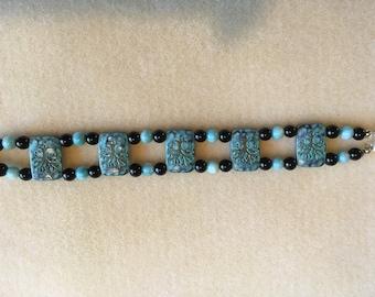 Aqua and black two-strand bracelet