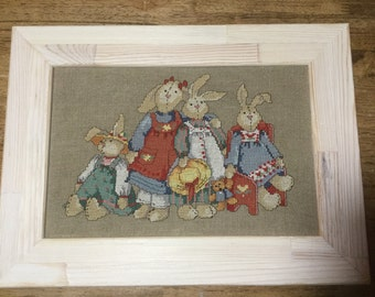 The cross stitch picture . Rabbits